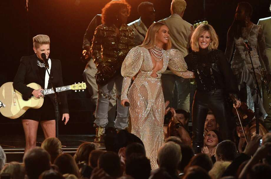Beyonce performs onstage with Martie Maguire of the Dixie Chicks at the 50th annual CMA Awards at the Bridgestone Arena on Nov. 2 in Nashville, Tenn. (Photo: Rick Diamond/Getty Images) Photo: Rick Diamond, Staff / 2016 Getty Images