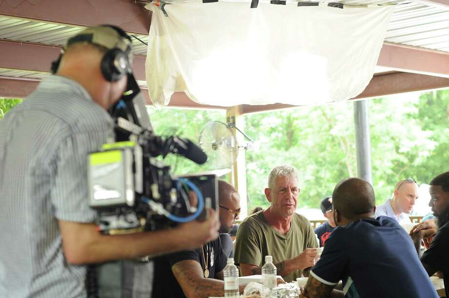 """Parts Unknown"" host Anthony Bourdain, second from left, is filmed at Burns Original BBQ in June. (File Photo) Photo: Dave Rossman, Freelance / Dave Rossman"