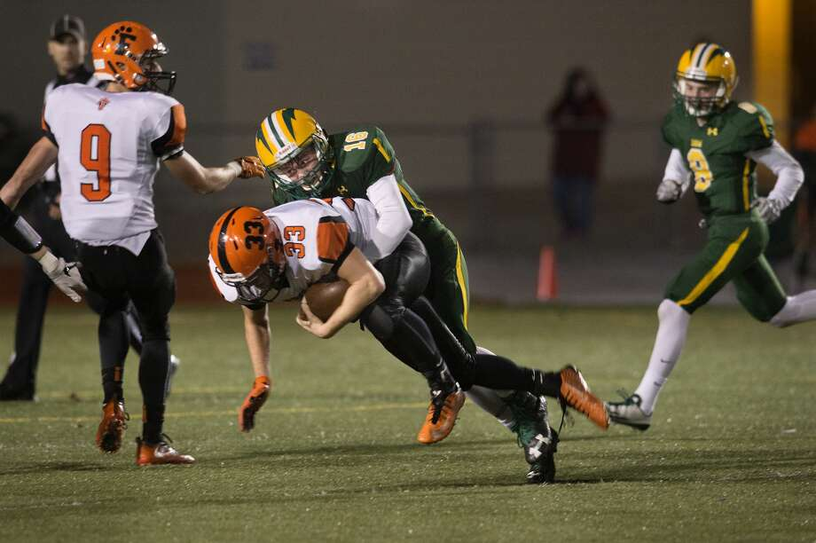 Dow High's Nick Sierocki tackles Fenton High's Dylan Crankshaw in the first half of Dow's Division 2 playoff game Friday night. Photo: Brittney Lohmiller/Midland Daily News/Brittney Lohmiller