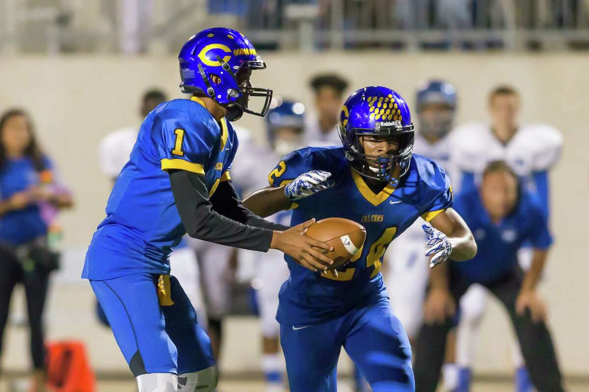 November 4 2016: Channelview quarterback Gerald Gardner passes the ball to running back De'Montre Tuggle during the Division 6A football game between the Sterling Rangers and Channelview Falcons in Channelview, Texas. (Leslie Plaza Johnson/Freelance)