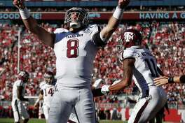 QB Trevor Knight celebrates a TD at Alabama, but it came during A&M's sole road loss this season.