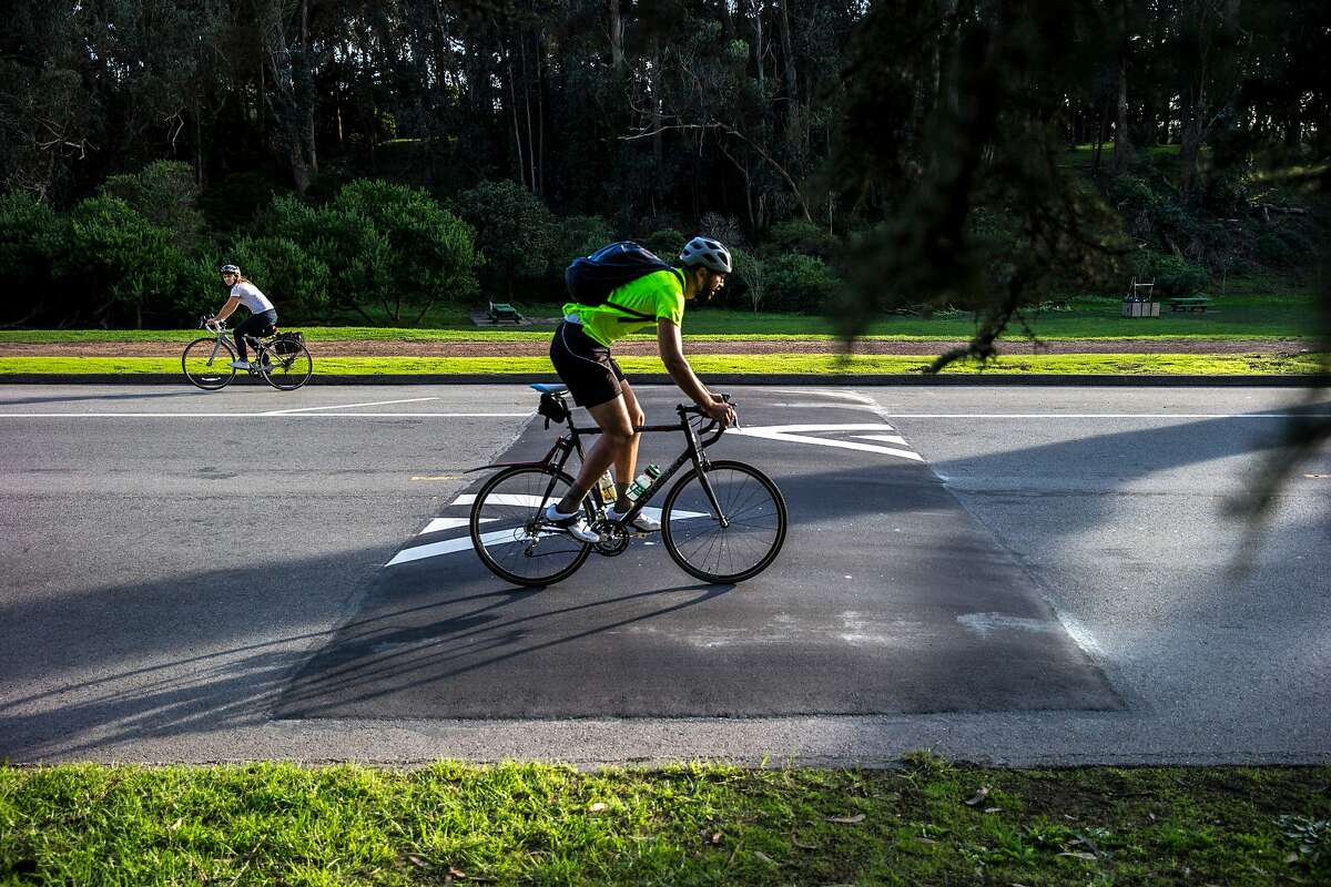 People ride over the new speed bumps along JFK Drive at Golden Gate Park, on Thursday, Nov. 3, 2016 in San Francisco, Calif. The speed bumps were installed, as part of a city-wide effort to reduce the number of bike fatalities in the city.