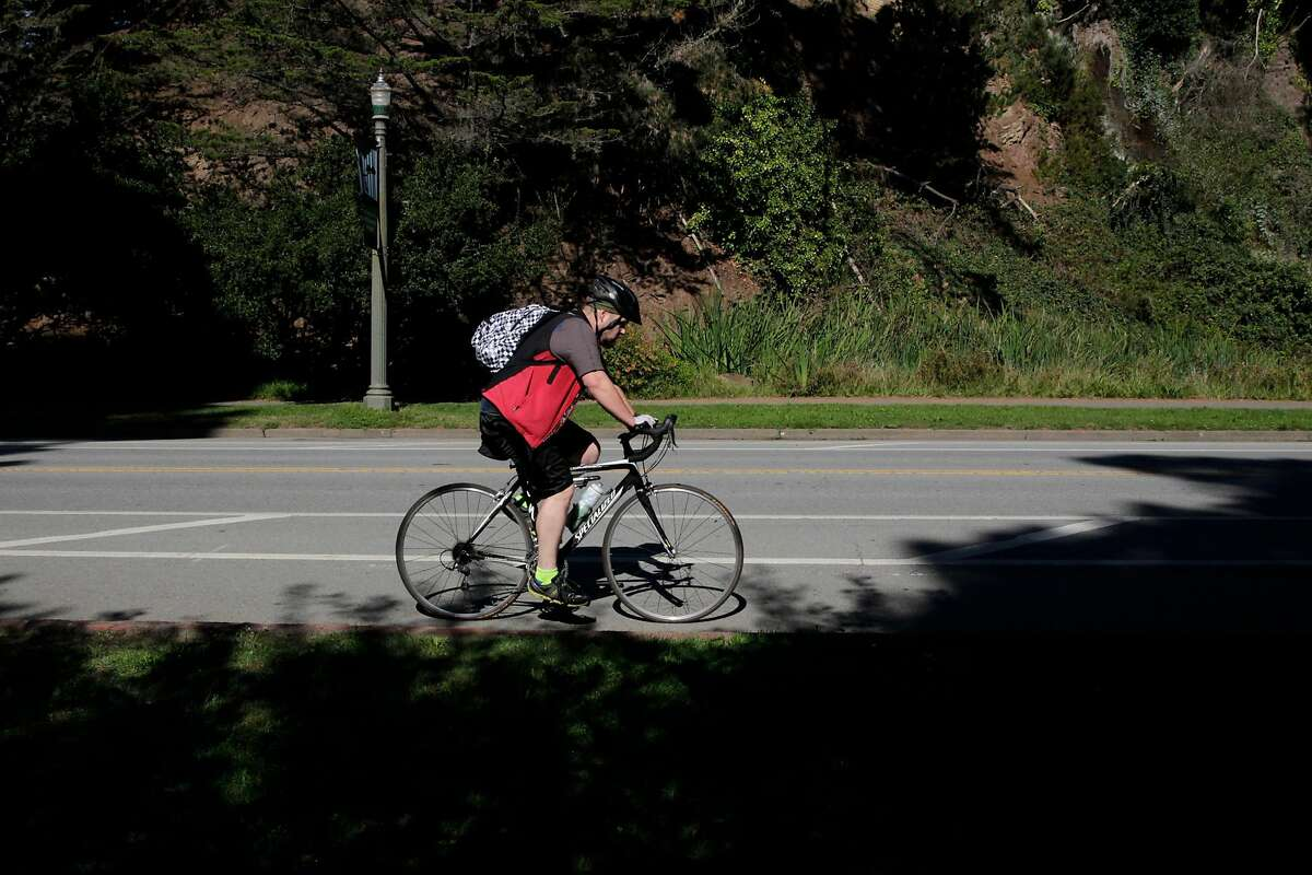 A pedestrian rides along John F. Kennedy Drive at Golden Gate Park on Friday, Oct. 21, 2016 in San Francisco, Calif. The Parks and Recreation department is planning to install nine speed bumps to reduce road deaths.