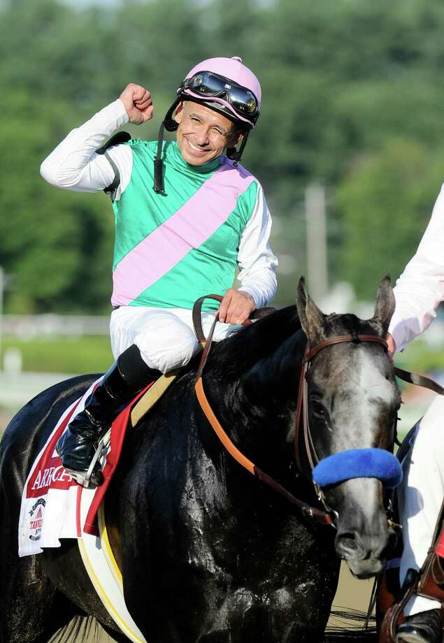 """FILE - In this Aug. 27, 2016, file photo, Jockey Mike Smith celebrates aboard Arrogate after winning the Travers Stakes horse race at Saratoga Race Course in Saratoga Springs, N.Y. The ride is far from over for Smith, even at age 51. The jockey known as """"Big Money Mike"""" is poised for another lucrative weekend in the Breeders' Cup at Santa Anita with mounts in the $2 million Distaff on unbeaten Songbird on Friday and in the $6 million Classic aboard Travers winner Arrogate on Saturday. (AP Photo/Hans Pennink, File) ORG XMIT: NY173 Photo: Hans Pennink / FR58980 AP"""