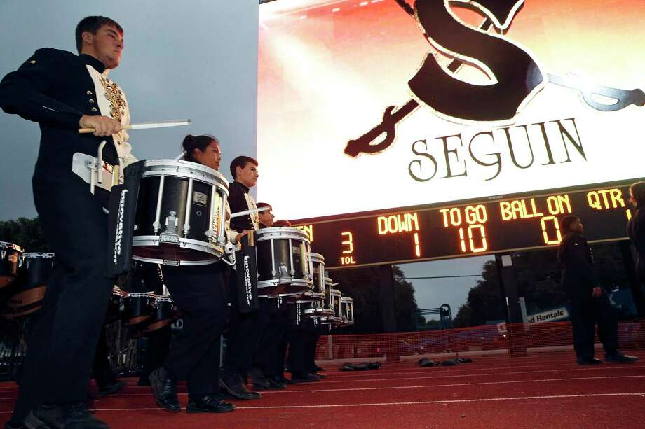 Band members march into the stadium as Seguin High School shows off its new video scoreboard at Matador Stadium as the team hosts Boerne Champion in the final regular season game on November 4, 2016. Photo: Tom Reel, Staff / San Antonio Express-News / 2016 SAN ANTONIO EXPRESS-NEWS