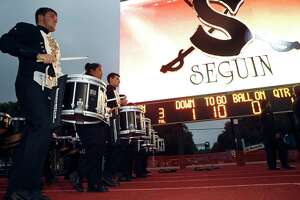 Band members march into the stadium as Seguin High School shows off its new video scoreboard at Matador Stadium as the team hosts Boerne Champion in the final regular season game on November 4, 2016.