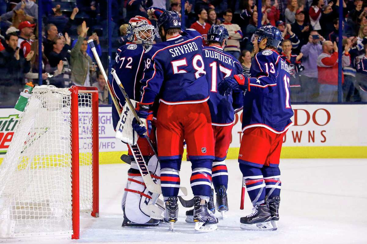 COLUMBUS, OH - NOVEMBER 4: Sergei Bobrovsky #72 of the Columbus Blue Jackets is congratulated by David Savard #58 of the Columbus Blue Jackets after stopping 30 shots and defeating the Montreal Canadiens 10-0 on November 4, 2016 at Nationwide Arena in Columbus, Ohio.