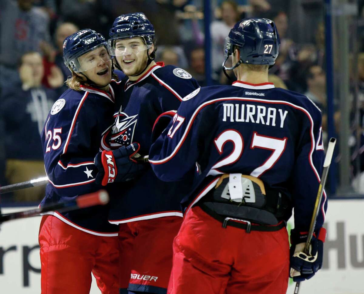 Columbus Blue Jackets forward William Karlsson, left, of Sweden, defenseman Josh Anderson and defenseman Ryan Murray celebrate Anderson's goal against the Montreal Canadiens during the second period of an NHL hockey game in Columbus, Ohio, Friday, Nov. 4, 2016. The Blue Jackets won 10-0. (AP Photo/Paul Vernon)