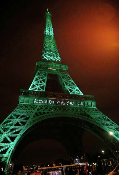 "The Eiffel Tower lit up in green to mark the success of the Paris Agreement, Friday Nov.4, 2016 in Paris. The Paris Agreement on climate change enters into force Friday faster than anyone had anticipated, after a year with remarkable success in international efforts to slash man-made emissions of carbon dioxide and other global warming gases. Inscription reads, ""it's done"".(AP Photo/Michel Euler) Photo: Michel Euler, STF / Copyright 2016 The Associated Press. All rights reserved."