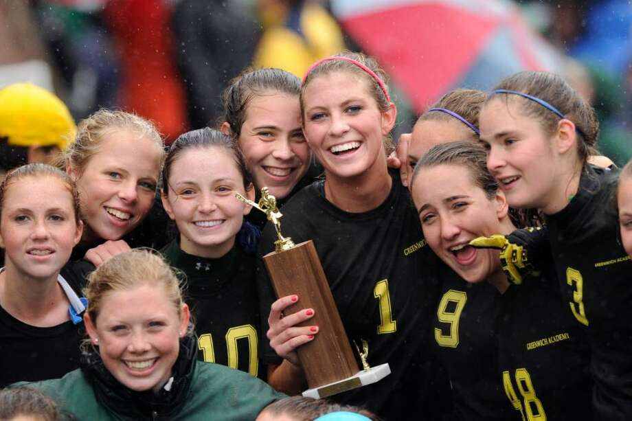 Members of the Greenwich Academy girls lacrosse team celebrate their 10-8  FAA Championship victory over rival Convent of the Sacred Heart, at GA, , Tuesday, May 18, 2010.  They are, Hannah Bacon (lower left) Kara Sperry, Emily Conway, Sarah Canning, Kathryn Stack, Lilly Fast (holding trophy), Caroline Feeley,  and Alexa Pujol (far right), Tuesday. Photo: Bob Luckey / Greenwich Time