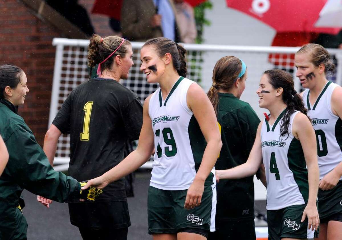 Convent of the Sacred Heart captain, Deidre Miller, # 19, center, congratulates Sarah Canning, left, at the end of the FAA Championshop game at GA which GA won 10-8. Also in photo are Annie Verrochi, # 4, and Gillian Burkett, # 30, of CSH, # 1 for GA is Lilly Fast.