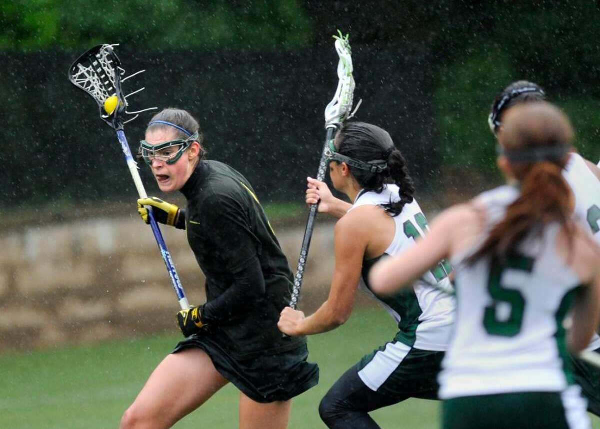 Lilly Fast of GA is covered by Convent's Alli Sciarretta, # 18, during lst half action of FAA Championship game against Convent of the Sacred Heart, at GA, Tuesday, May 18, 2010. At far right is Convent's Taylor Ryan. GA won the chmapionship 10-8.