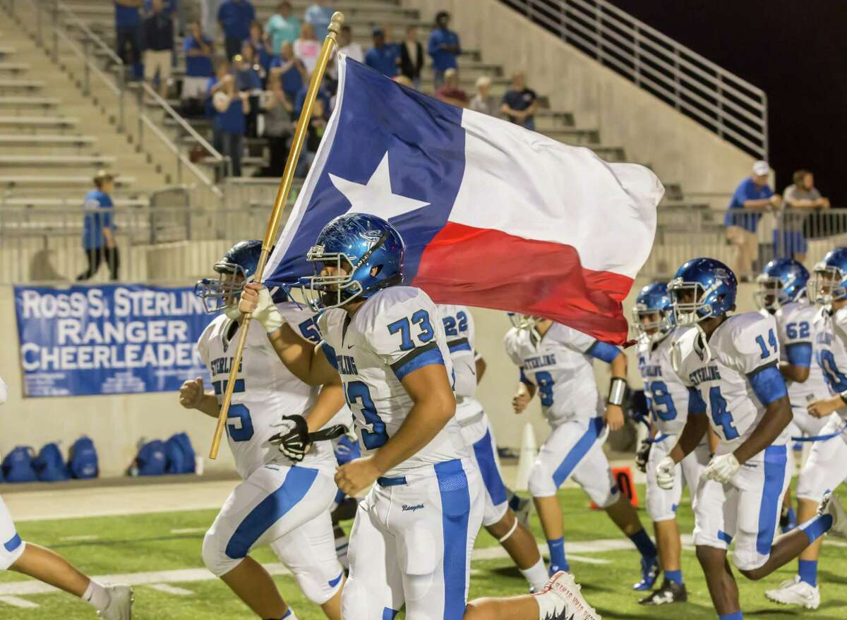 November 4 2016: Sterling Rangers carry the Texas flag onto the field during the Division 6A football game between the Sterling Rangers and Channelview Falcons in Channelview, Texas. (Leslie Plaza Johnson/Freelance)