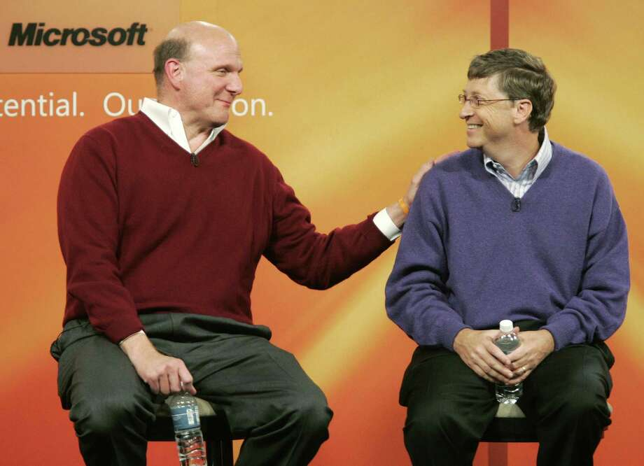 In this June 15, 2006 file photo, Microsoft Corp. Chairman Bill Gates, right, looks at Microsoft CEO Steve Ballmer after Gates announced that he will transition from day-to-day responsibilities at the company he co-founded to concentrate on the charitable work of the Bill & Melinda Gates Foundation. Two years later, Microsoft's iconic frontman is finally giving up his full-time gig at the company to devote more time to world health charity work. (AP Photo/Ted S. Warren, file) Photo: TED S. WARREN, STF / AP
