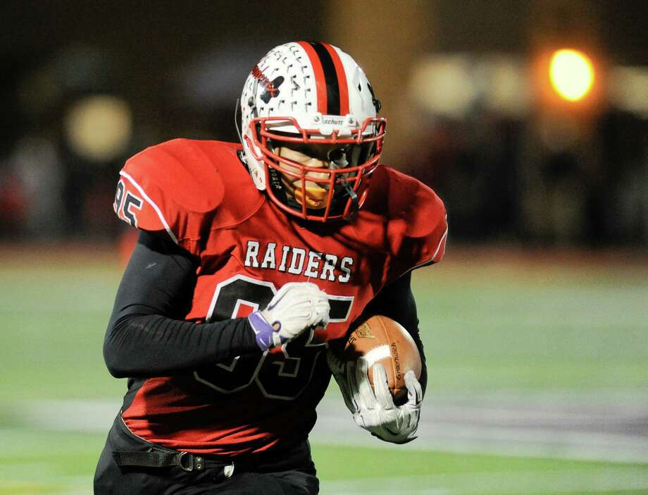 Mechanicville's Spencer Morgan (95) runs the ball against Greenwich during their Section II Class C high school Super Bowl football game in Lansingburgh, N.Y., Friday, Nov. 4, 2016. (Hans Pennink / Special to the Times Union)   ORG XMIT: HP114 Photo: Hans Pennink / Hans Pennink