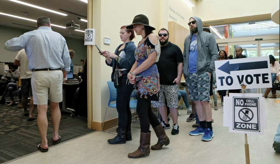 Voters in Atlanta line up to cast early ballots Friday. Hillary Clinton and Donald Trump have stepped up campaigning with only four days to Election Day. Photo: Bob Andres, MBO / 2016 Atlanta Journal Constitution