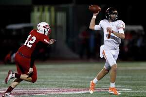 St. Pius X's quarterback Grant Gunnell (7) prepares to pass the ball during the second half of a high school football game between St. Pius X and St. Thomas High Schools at St. Thomas, Friday,Nov. 4, 2016 in Houston.