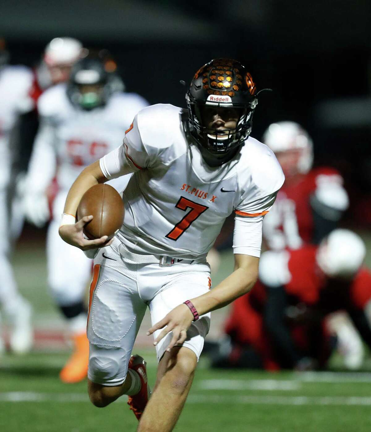 St. Pius X's quarterback Grant Gunnell (7) runs the ball during the second half of a high school football game between St. Pius X and St. Thomas High Schools at St. Thomas, Friday,Nov. 4, 2016 in Houston.