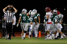 De La Salle Spartans cornerback Tre White (20) celebrates sacking the quarterback for a fourth down, during the first quarter of a high school football game between the De La Salle Spartans (Concord) and the Monte Vista Mustangs (Danville) on Friday, Nov. 4, 2016 in Concord, Calif.