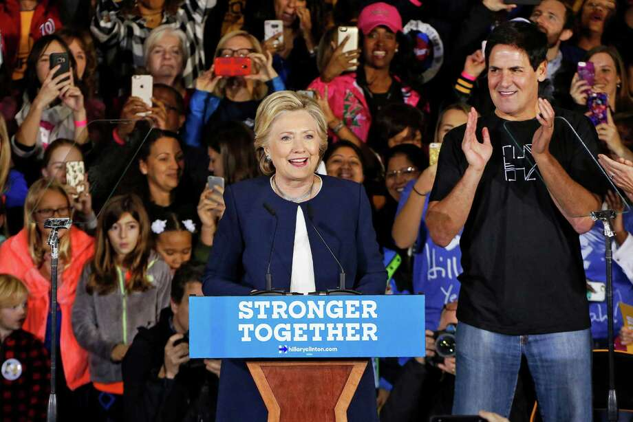 Dallas Mavericks basketball team owner, Pittsburgh native Mark Cuban, applauds at right after introducing Democratic presidential candidate Hillary Clinton at a Pennsylvania Democrats Pittsburgh Organizing Event at Heinz Field in Pittsburgh, Friday, Nov. 4, 2016. (AP Photo/Gene J. Puskar) ORG XMIT: PAGP103 Photo: Gene J. Puskar / Copyright 2016 The Associated Press. All rights reserved.