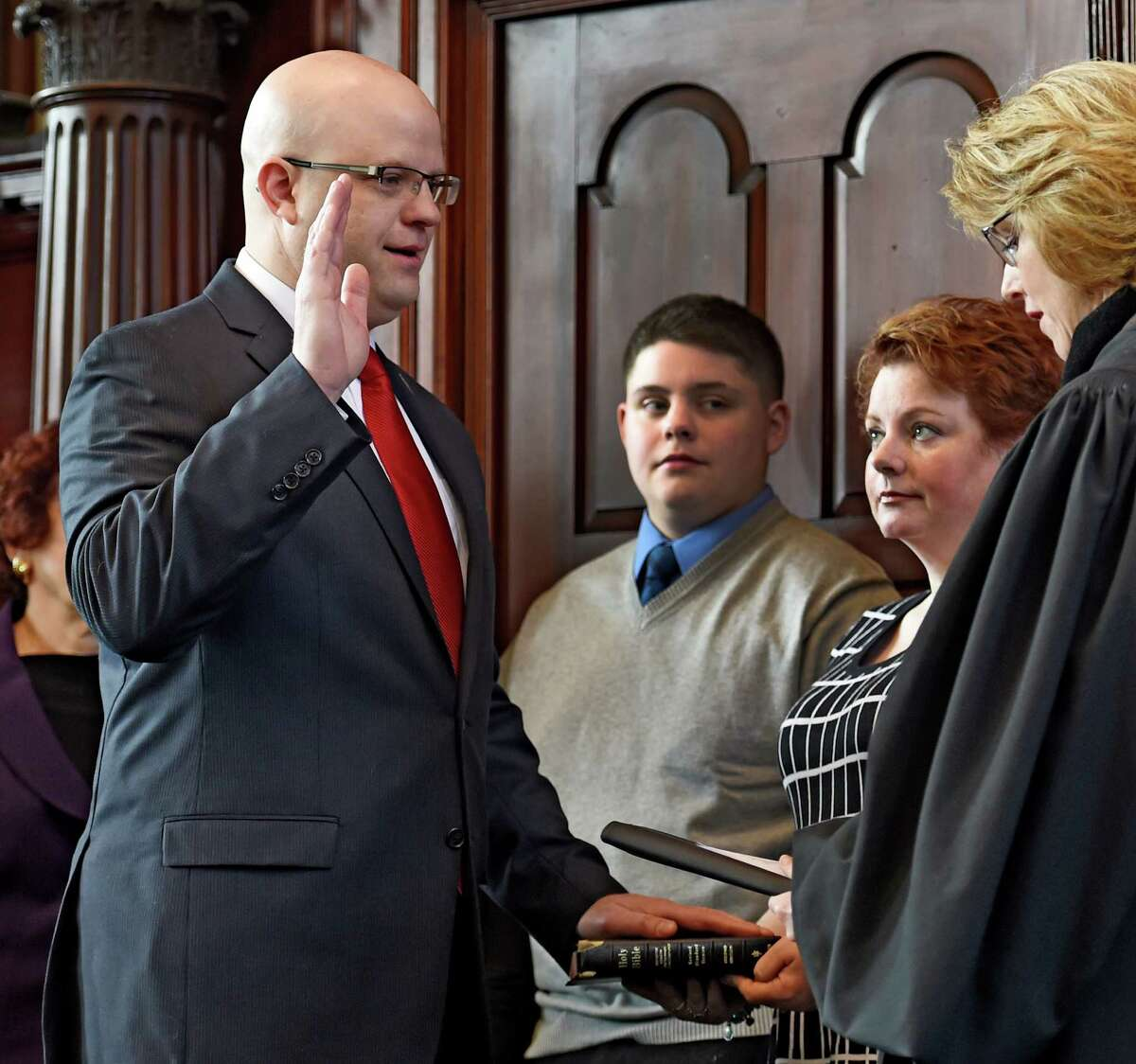 Rensselaer County District Attorney Joel Abelove, left, was sworn in on Jan. 1, 2015, by County Judge Debra Young as family members watched at the Rensselaer County Courthouse in Troy, N.Y. (Skip Dickstein/Times Union archive)