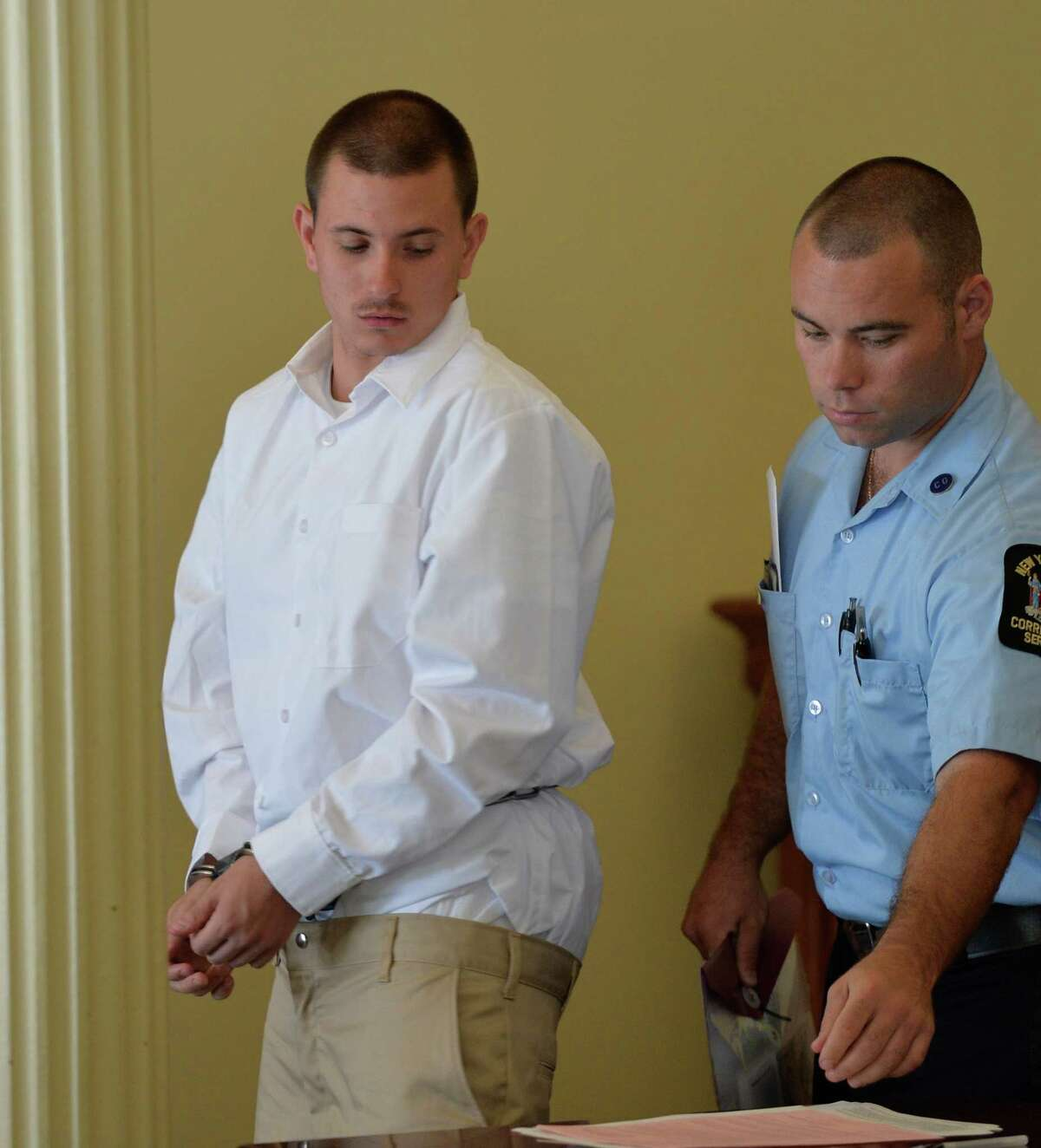 Defendant John Halacy leaves the courtroom after his sentencing in Rensselaer County Court on Monday morning, Aug. 25, 2014, in Troy, N.Y. (Skip Dickstein/Times Union archive)