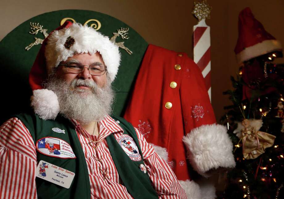 Lance McLean poses along with his Santa Claus coat at his home Thursday, Oct. 27, 2016, in Pearland.  He works as a professional Santa Claus during the holidays. ( Melissa Phillip / Houston Chronicle ) Photo: Melissa Phillip, Staff / © 2016 Houston Chronicle