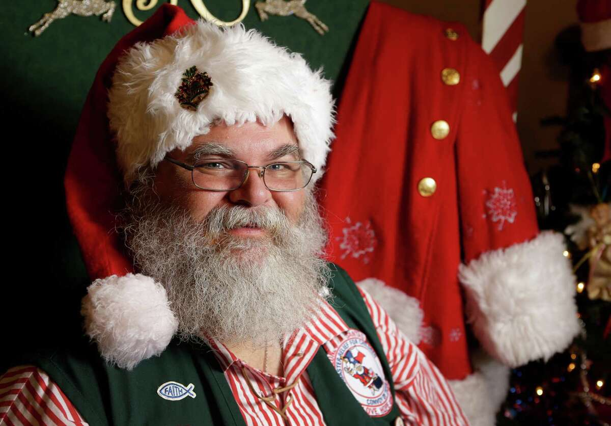 Lance McLean poses along with his Santa Claus coat at his home Thursday, Oct. 27, 2016, in Pearland. He works as a professional Santa Claus during the holidays. ( Melissa Phillip / Houston Chronicle )
