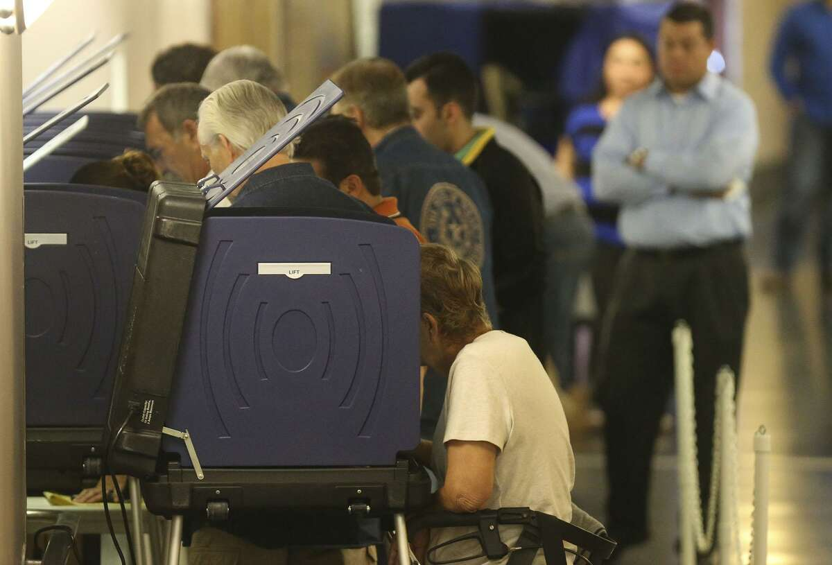 People vote at the Bexar County Justice Center Friday November 4, 2016 on the last day of early voting for the 2016 election.