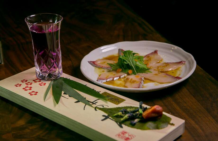 Sakura Festival cocktail from the cocktail omakase menu paired with amberjack sashimi with truffle oil and mizuna. Photo: John Storey