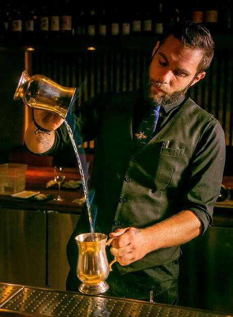 "Bartender Alex Riddle makes the ""Wakakusa Yamayaki Festival"" cocktail from the Cocktail Omakase menu at Roka Akor in San Francisco, Calif. is seen on November 4th, 2016. Photo: John Storey"