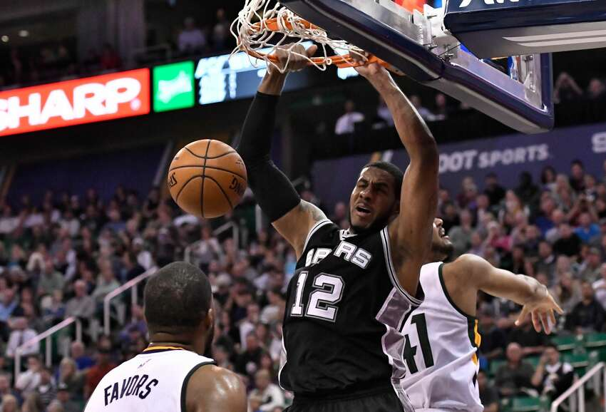 SALT LAKE CITY, UT - NOVEMBER 04: LaMarcus Aldridge #12 of the San Antonio Spurs scores between the defense of Derrick Favors #15 and Trey Lyles #41 of the Utah Jazz in the second half of the Spurs 100-86 win at Vivint Smart Home Arena on November 4, 2016 in Salt Lake City, Utah. NOTE TO USER: User expressly acknowledges and agrees that, by downloading and or using this photograph, User is consenting to the terms and conditions of the Getty Images License Agreement. (Photo by Gene Sweeney Jr/Getty Images)