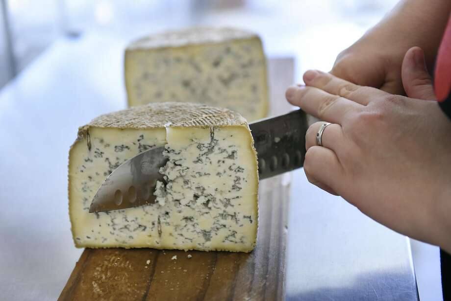Owner Seana Doughty cuts a wheel of Buff Blue cheese. Photo: Michael Short, Special To The Chronicle