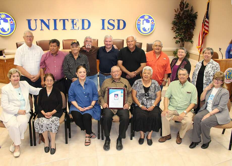 Honoree Jose Luis Salas (center) and wife Raquel Salas pose with his former building trades students from the class of 1968 and former United ISD educators Sylvia Bruni and Joe Trevino. Photo: Courtesy Photo /United ISD