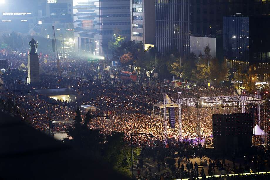 """South Korean protesters stage a rally calling for South Korean President Park Geun-hye to step down in downtown Seoul, South Korea, Saturday, Nov. 5, 2016. Tens of thousands of South Koreans poured into the streets of downtown Seoul on Saturday, using words including """"treason"""" and """"criminal"""" to demand that Park step down amid an explosive political scandal. (AP Photo/Ahn Young-joon) Photo: Ahn Young-joon, Associated Press"""