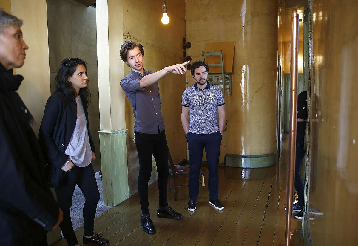 Tour guide Andrew Sheets (pointing) gives a tour of the hallway at the David Ireland House on Friday, November 4, 2016, in San Francisco, Calif. In its first year as a private museum, the David Ireland House has served 5,000 people on guided tours of 8, that costs $20 per person.