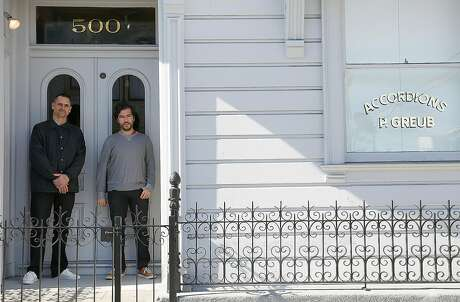 Curators Bob Linder (left) and Diego Villalobos (right) at the entrance to the David Ireland House on Friday, November 4, 2016, in San Francisco, Calif. In its first year as a private museum, the David Ireland House has served 5,000 people on guided tours of 8 for $20 per person. Photo: Liz Hafalia / The Chronicle