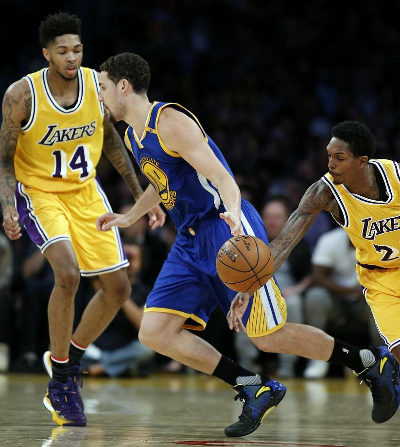 Los Angeles Lakers guard Louis Williams, right, steals the ball from Golden State Warriors guard Klay Thompson, center, with forward Brandon Ingram (14) watching during the second half of an NBA basketball game in Los Angeles, Friday, Nov. 4, 2016. Lakers won 117-97. (AP Photo/Alex Gallardo) Photo: Alex Gallardo, Associated Press