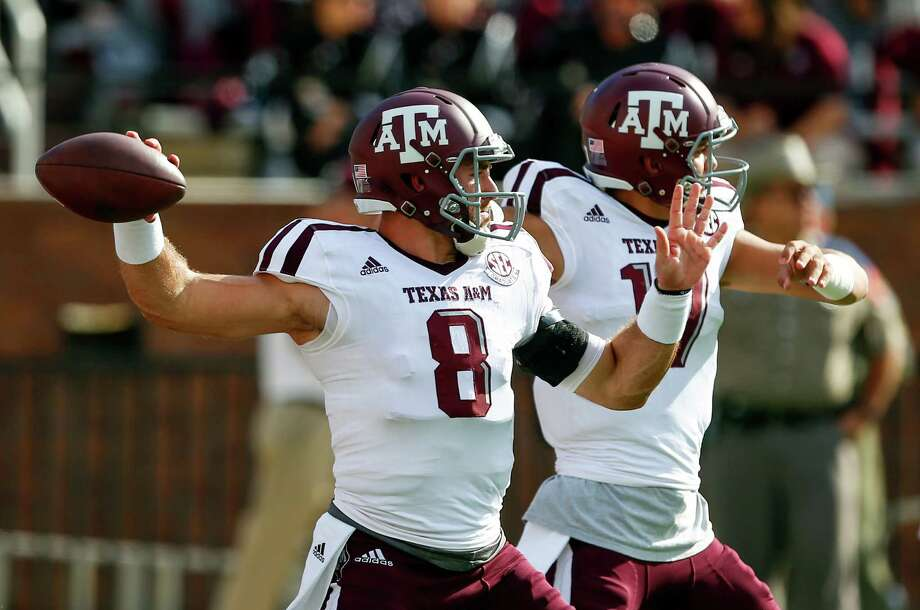 STARKVILLE, MS - NOVEMBER 5:  Quarterback Trevor Knight #8 of the Texas A&M Aggies and quarterback Nick Starkel #17 warm up before the start of an NCAA college football game against the Mississippi State Bulldogs at Davis Wade Stadium on November 5, 2016 in Starkville, Mississippi. Photo: Butch Dill, Getty Images / 2016 Getty Images