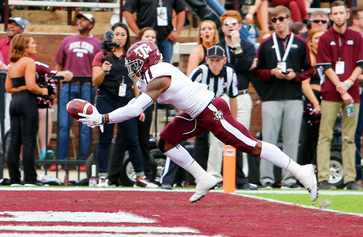 STARKVILLE, MS - NOVEMBER 5: Defensive back Nick Harvey #1 of the Texas A&M Aggies intercepts a pass in the end zone during the first half of an NCAA college football game against the Mississippi State Bulldogs at Davis Wade Stadium on November 5, 2016 in Starkville, Mississippi.