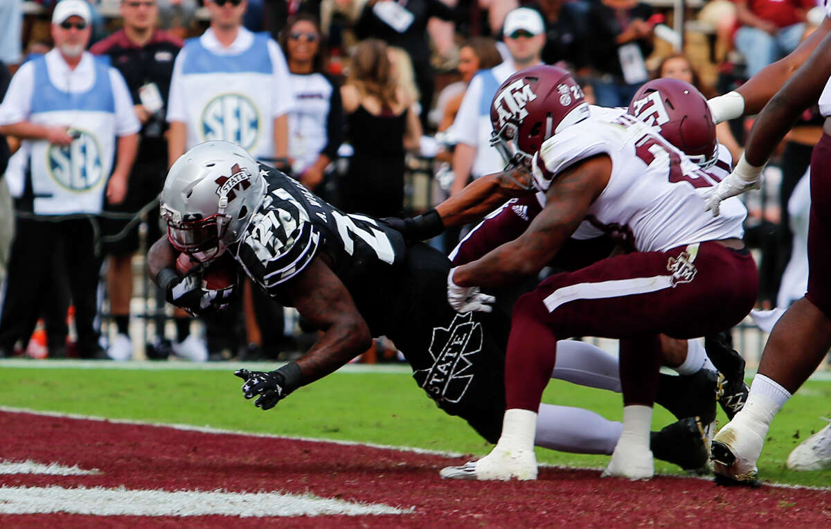 STARKVILLE, MS - NOVEMBER 5: Running back Aeris Williams #27 of the Mississippi State Bulldogs dives in for a touchdown as defensive back Armani Watts #23 of the Texas A&M Aggies tries to tackle him during the first half of an NCAA college football game at Davis Wade Stadium on November 5, 2016 in Starkville, Mississippi.