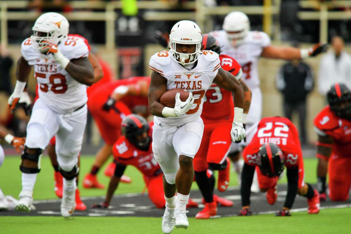 LUBBOCK, TX - NOVEMBER 05: D'Onta Foreman #33 of the Texas Longhorns break free for yardage during the first half of the game between the Texas Tech Red Raiders and the Texas Longhorns on November 5, 2016 at AT&T Jones Stadium in Lubbock, Texas.