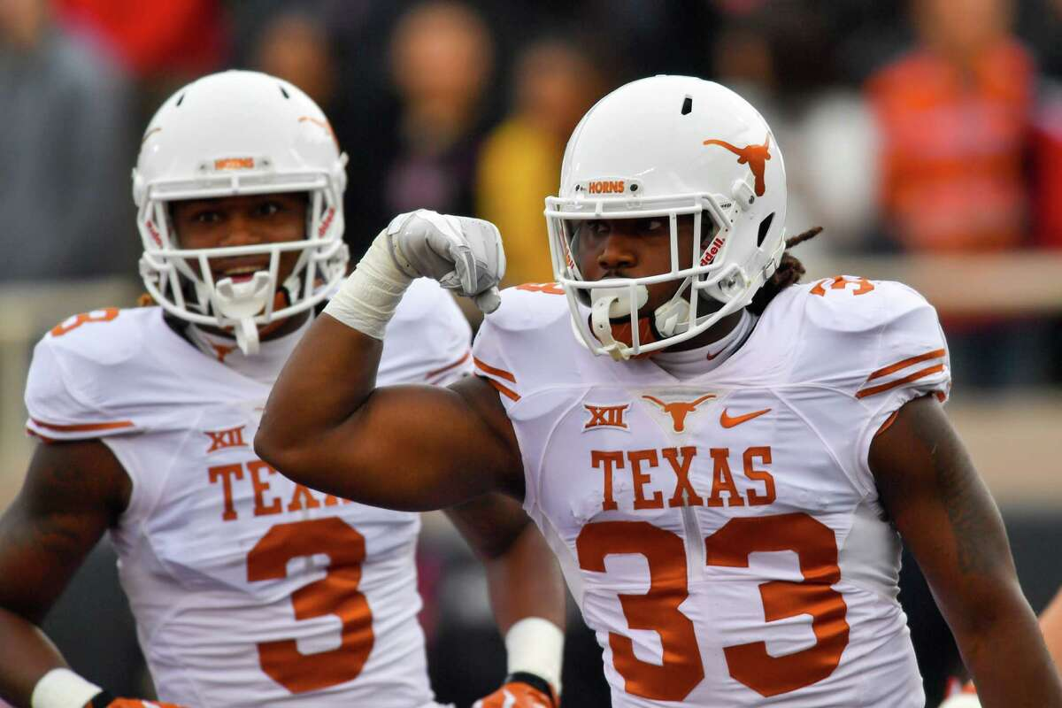 LUBBOCK, TX - NOVEMBER 05: D'Onta Foreman #33 of the Texas Longhorns reacts to scoring a touchdown during the first half of the game between the Texas Tech Red Raiders and the Texas Longhorns on November 5, 2016 at AT&T Jones Stadium in Lubbock, Texas.