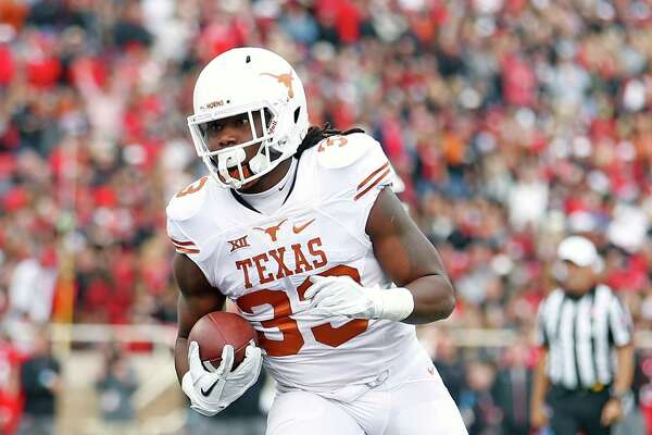 Texas' D'Onta Foreman (33) runs the ball into the end zone during an NCAA college football game against Texas Tech, Saturday, Nov. 5, 2016, in Lubbock, Texas. (Brad Tollefson/Lubbock Avalanche-Journal via AP)