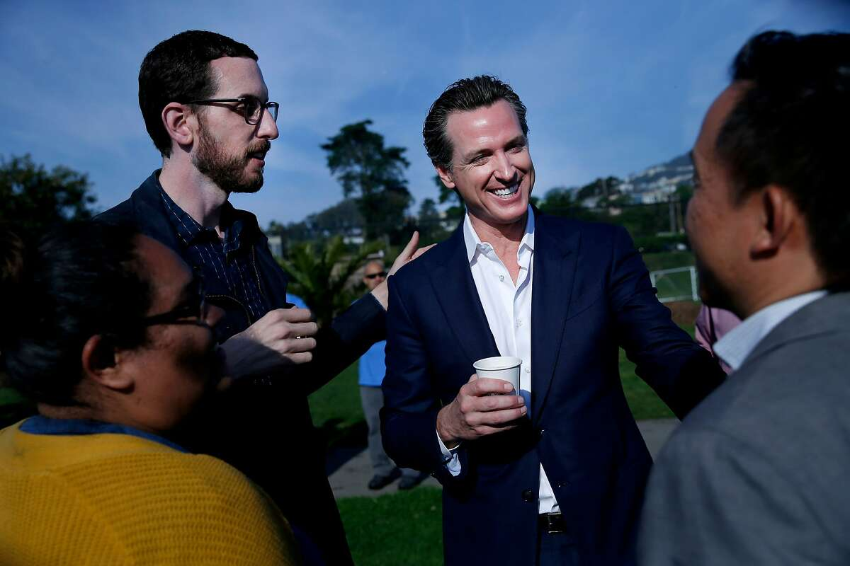 From left facing camera: Scott Wiener and Gavin Newsom, during a get-out-the-vote rally at Balboa Park on Nov. 5 in San Francisco.