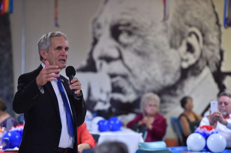 U.S. Rep. Lloyd Doggett, D-Austin, in front of a mural of the late U.S. Rep. Henry B. Gonzalez at Estela's Mexican Restaurant before the 2016 general election. The West Side building's new owner has painted over the murals. Photo: Robin Jerstad /San Antonio Express-News / ROBERT JERSTAD