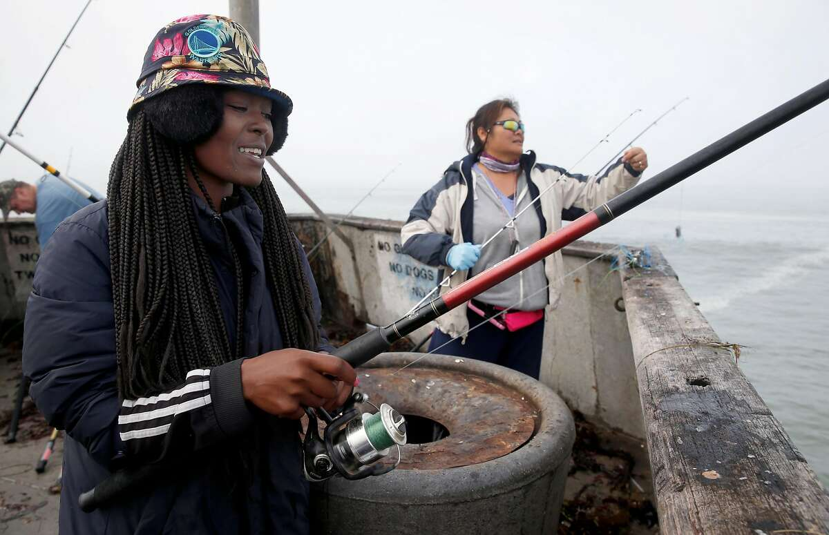 """Evelyn """"Muffin"""" Strauter goes crabbing on the municipal pier with Connie Seers (right) during the first day of the recreational Dungeness crab season in Pacifica, Calif. on Saturday, Nov. 5, 2016. Despite all of the enthusiasm, veteran crabbers say conditions were less than ideal as heavy surf continually pounded the pier."""