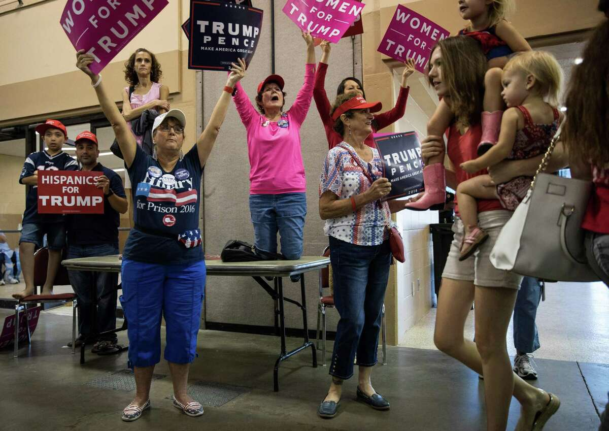 Supporters cheer as Donald Trump speaks at a campaign event at the Florida State Fairgrounds in Tampa, Fla., Nov. 5, 2016. (Damon Winter/The New York Times)