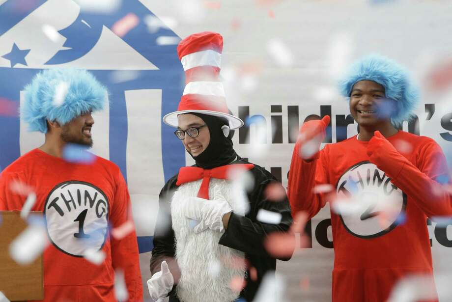 Thing 1, Winstone Saniel, left, and Thing 2, Kevonte Miller, right, celebrate with The Cat In Hat, Nicholas Cuellar, center, as confetti rains down after the Cat won during The Cat In The Hat Runs for President event at the Children's Museum of Houston 1500 Binz, Saturday, Nov. 5, 2016, in Houston. Children cast votes for either The Cat In The Hat or Thing1 and Thing2. Photo: Melissa Phillip, Houston Chronicle / © 2016 Houston Chronicle
