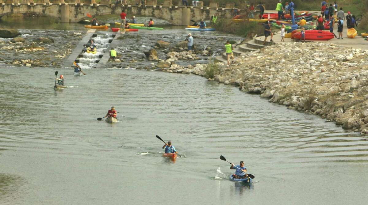 Kayakers near Concepción Park take part in the River Relay & Get Outdoors race and festival. The 4-kilometer race was accompanied by a 5-kilometer run.